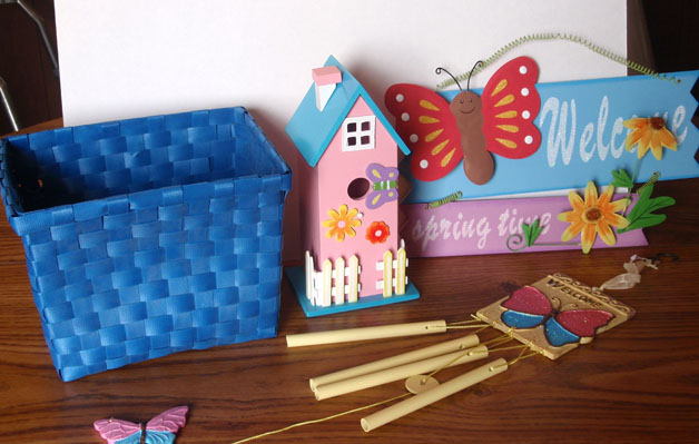 Butterfly welcome sign, windchime, birdhouse, and basket