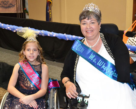 Our adult titleholder and Little Miss take a picture after the crowning