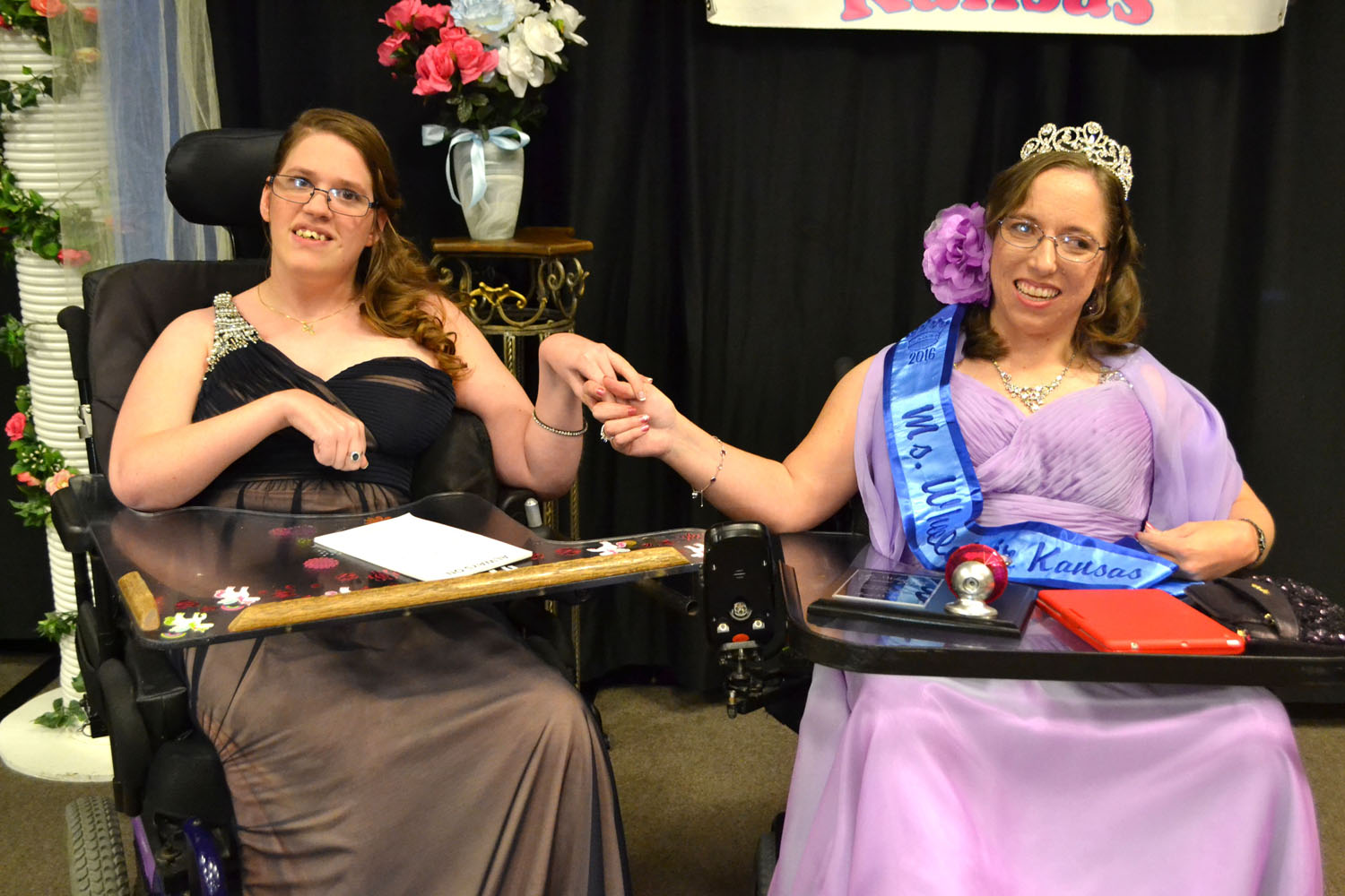 Keara and Tiffany hold hands after the crowning