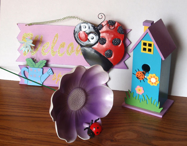 Ladybug flower stake, welcome sign, and birdhouse
