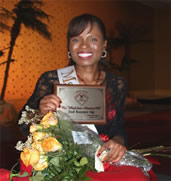 Ranita posing with her 2nd runner up award and flowers